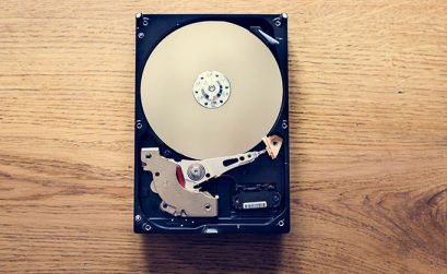 Hard Drive On A Wooden Background